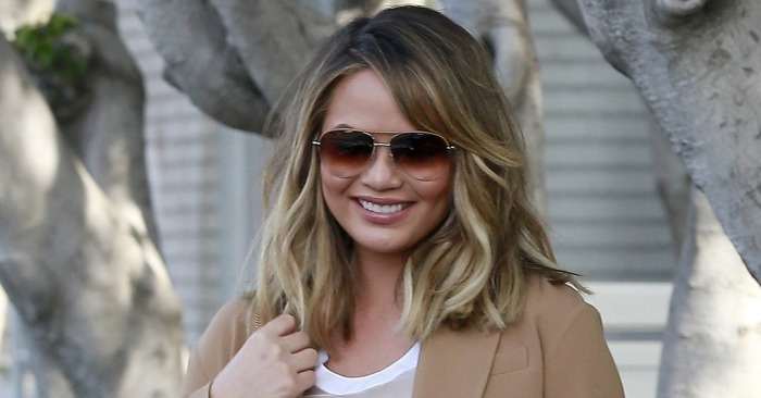 Chrissy Teigen Flaunts Her Bare Belly During a Low-Key Outing With John Legend and Her Mom